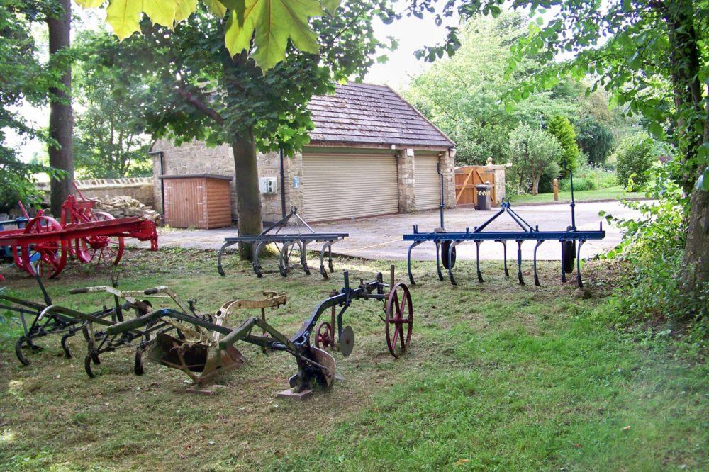 Vintage ploughs looking into carpark